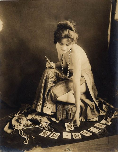 Topless woman fortune telling