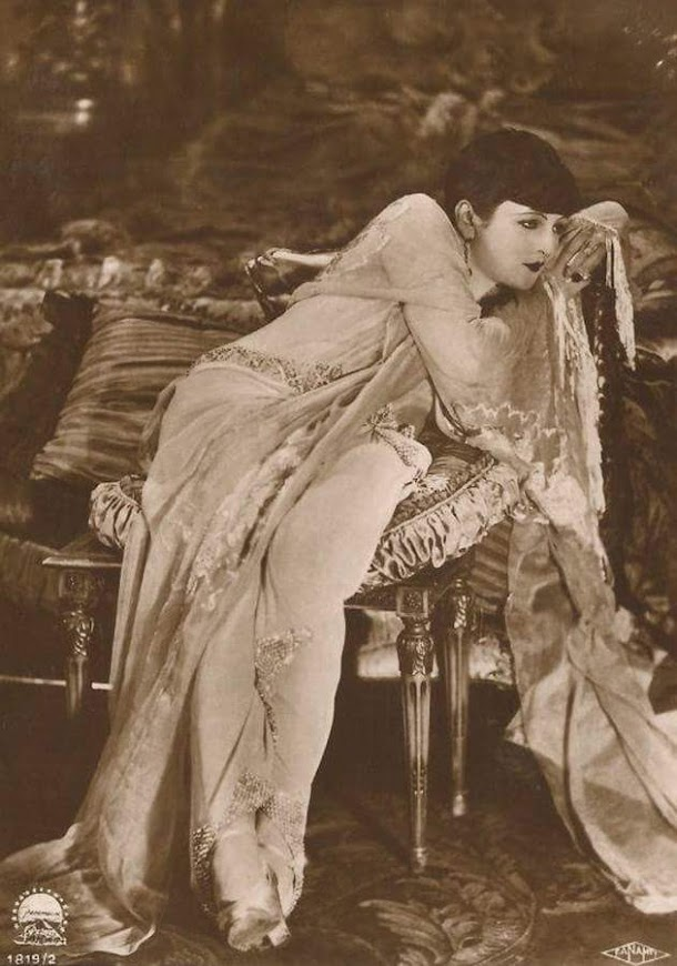 flapper reclining while wearing a negligee
