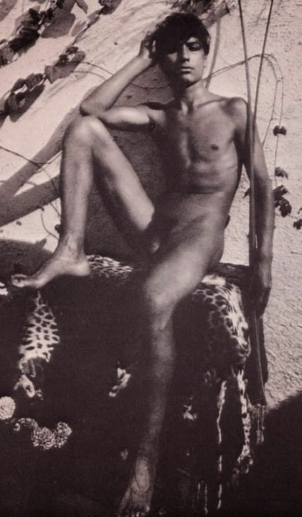 Vintage nude young man sitting on a leopard skin