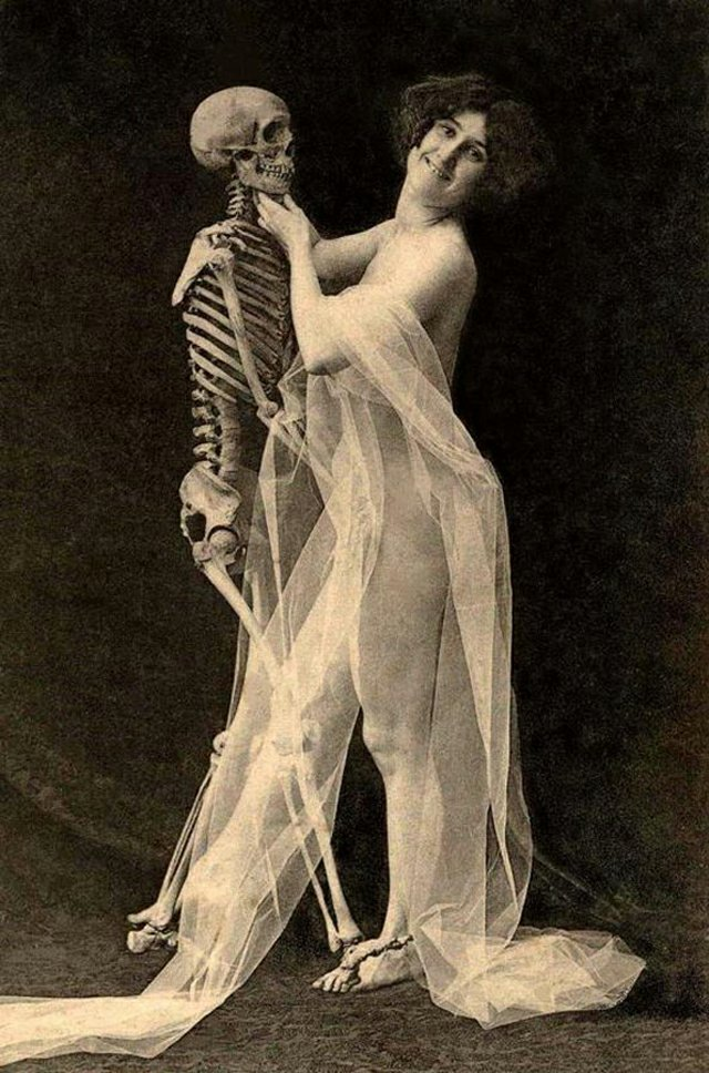 nude woman with a skeleton