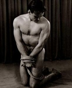 bound kneeling man