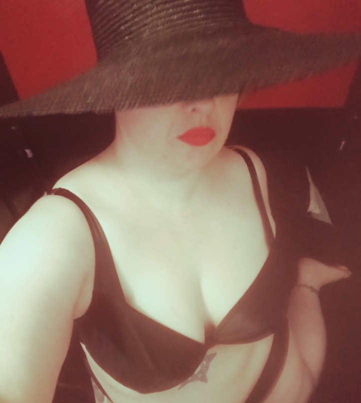 Lascivious Lucy in a black sunhat and black lingerie