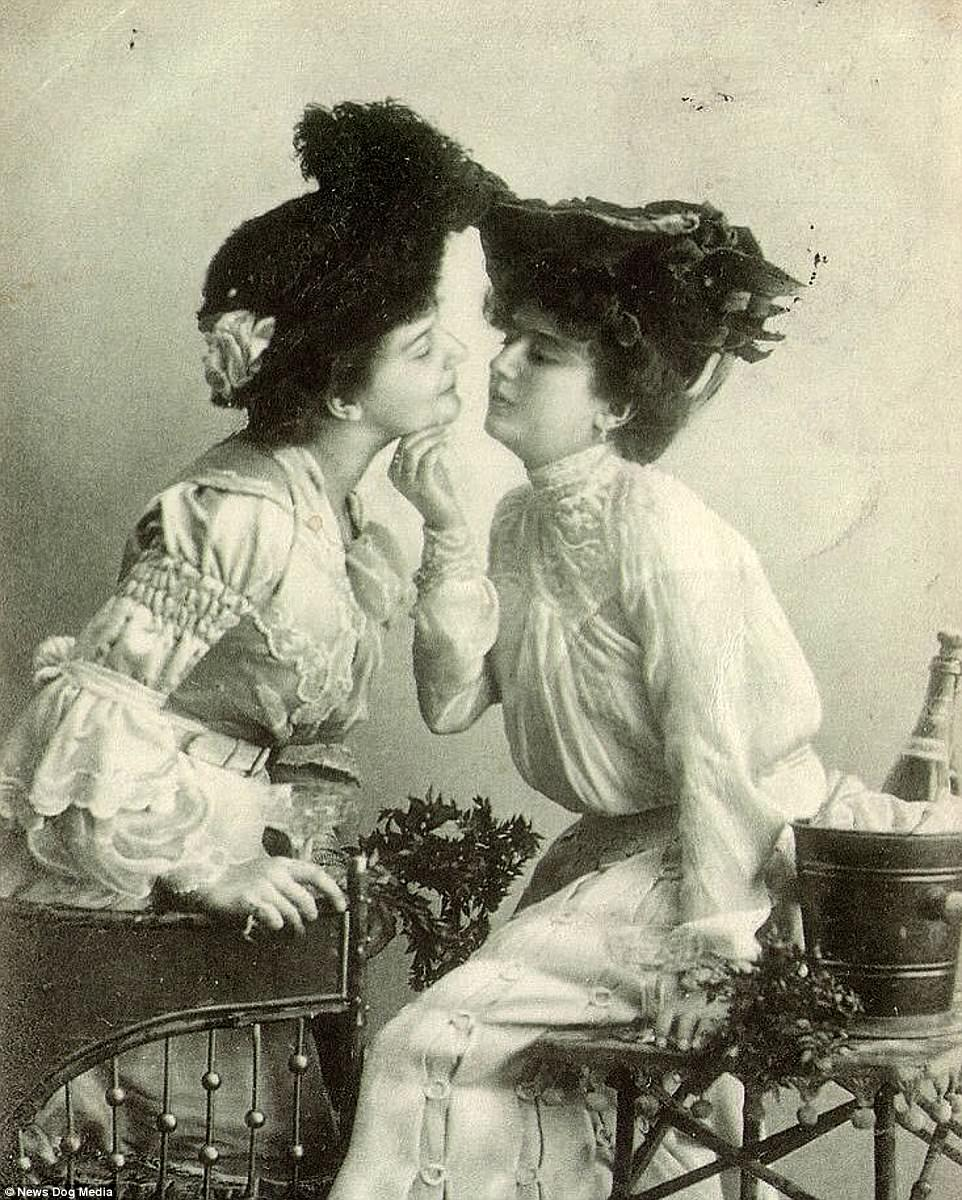 Two women in Victorian clothing preparing to kiss