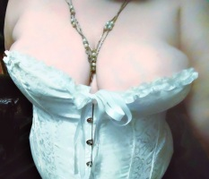 Author Lascivious Lucy in pearls and a white corset