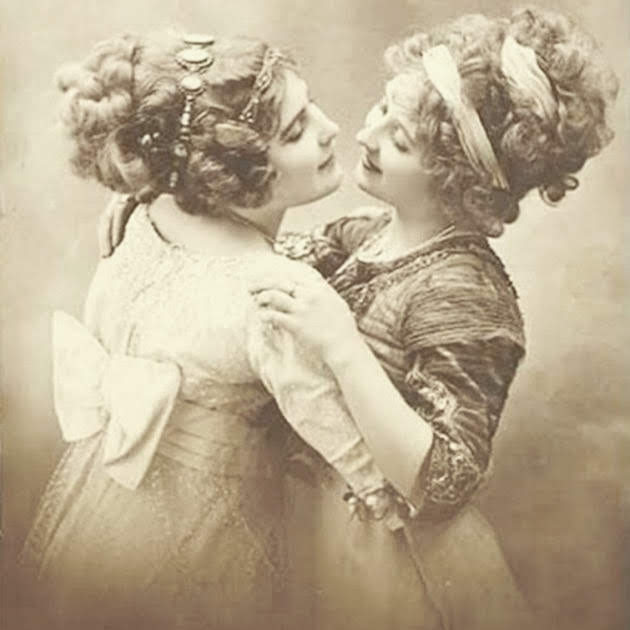 Two Victorian women dancing