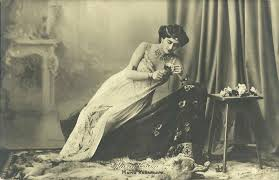 Woman in lace gown reclining