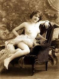 topless woman reclined on chair