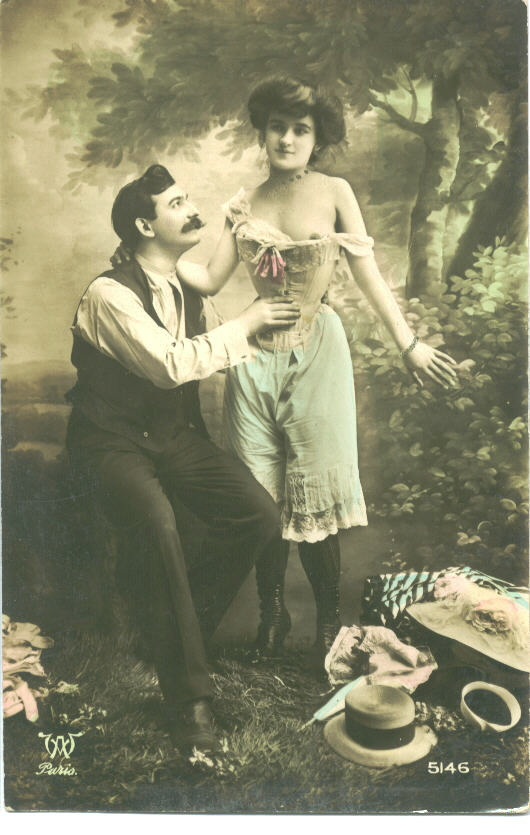 Victorian woman in underwear standing next to a clothed man