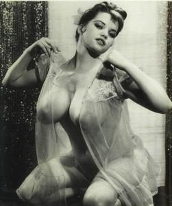 kneeling woman in sheer nightgown