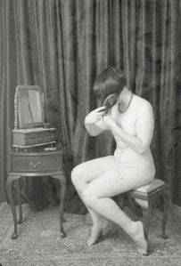 nude flapper with hair brush and vanity mirror