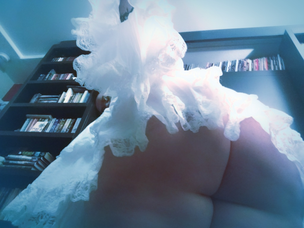 upskirt photo of Lucy wearing a white lace chemise
