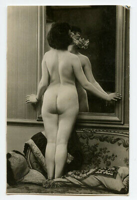 Nude flapper facing away from the mirror